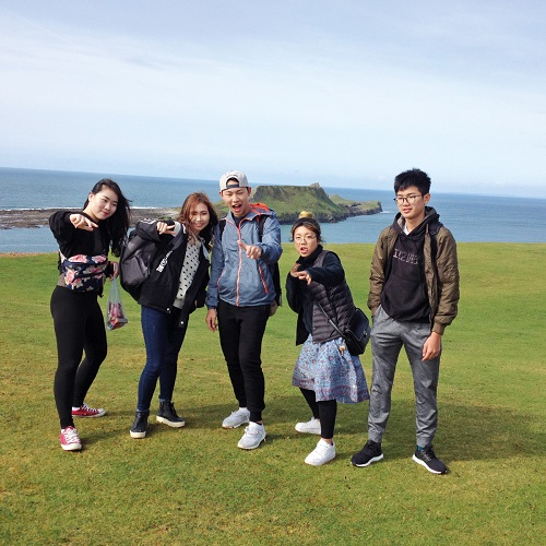 gower college asian students by sea